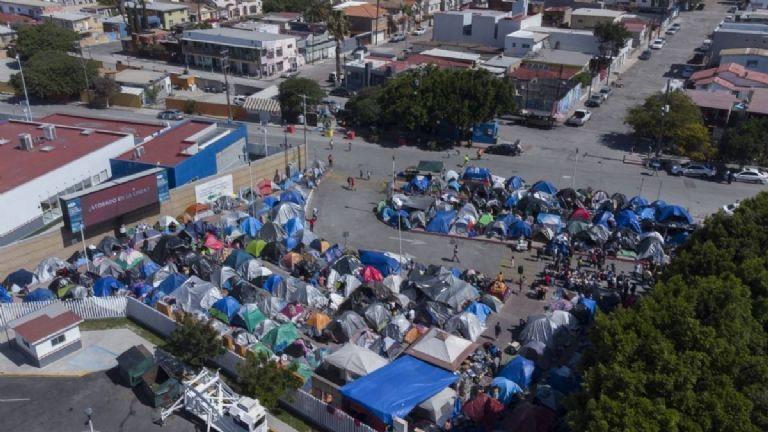 Migrants stranded in Tijuana camp live in precarious conditions